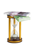 Financial investment. Money and hourglass the concept of banking financial investment, color image isolated on a white background Royalty Free Stock Images