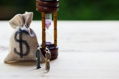 Financial investment negotiation,discussion among CEO or execute. Level concept: Miniature figurine three businessmen talk on money invest contract agreement royalty free stock photo