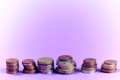 Financial light purple background with coins stacks and empty copy space. Stock Photography