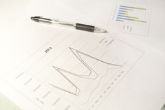 Line Chart. A financial line graph and a pen Stock Photography