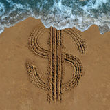 Financial Loss. Business concept as a drawing of a money symbol drawn on a beach being washed out by an ocean wave as an economic icon for currency change or Stock Image