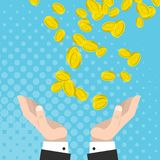 Financial luck, gold coins fall into the hands raised. A large monetary gain Stock Photo