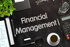 Financial Management on Black Chalkboard. 3D Rendering. Financial Management - Black Chalkboard with Hand Drawn Text and Stationery. Top View. 3d Rendering Royalty Free Stock Images