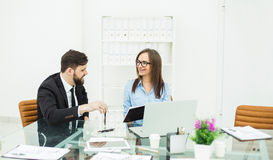 Financial Manager and accountant are hosting a discussion on business matters in the workplace Royalty Free Stock Image