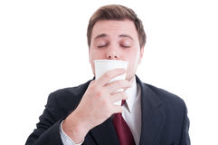Financial manager smelling fresh coffee from a paper cup Royalty Free Stock Photo