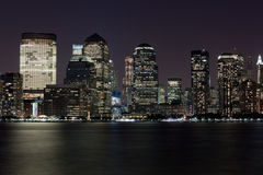 Financial Manhattan at Night over Hudson river Royalty Free Stock Images
