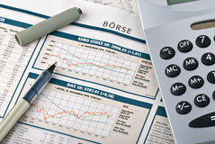 Financial market. Financial section of a newspaper and a calculator Stock Images