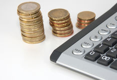 Financial market. A calculator with buttons tax - and plus together with a stack of coins Stock Photography