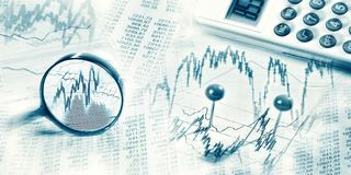 Financial market with magnifier and calculator Stock Image