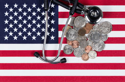 Financial medical concept with stethoscope and coins on the Unit Royalty Free Stock Image
