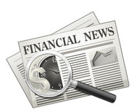 Financial news. Newspaper and Magnifying glass Royalty Free Stock Photography