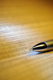 Financial newspape and pen Royalty Free Stock Images