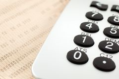 Financial newspaper with calculator Royalty Free Stock Photos