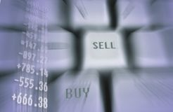 Financial numbers. Quotes projection on a keyboard with graph and buy and sell button Royalty Free Stock Images