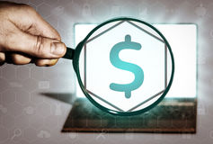 Financial operations, banking, lending, etc. Hand holds the magnifying glass in front of an open notebook. Among the many icons, attention is focused on the Royalty Free Stock Images