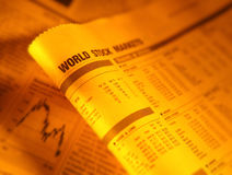 Financial page showing world stock market. Financial newspaper page showing world stock market stock images