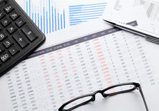Financial paper charts and graphs Stock Images
