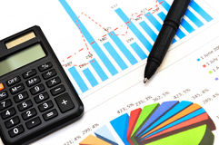 Financial paper charts and graphs Stock Photography