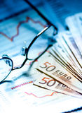 Financial paper and glasses. Financial paper with business page and glasses Royalty Free Stock Image
