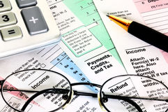 Financial papers with calculator, glasses and pen Stock Photos