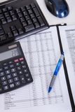 Financial papers calculator and pen Stock Photo