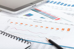 Financial papers, computer and office supplies Royalty Free Stock Image