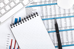 Financial papers, computer and office supplies Royalty Free Stock Photos