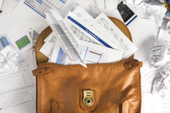 Financial Paperwork Spilling Out of Briefcase Stock Photography