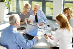 Financial people giving advice Stock Photos