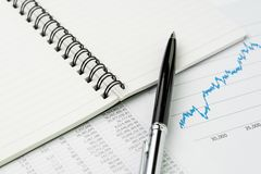 Financial performance report, market price list, stock, bond or. Equity analysis for investment concept, pen on notepad with graph and chart reports on table stock images