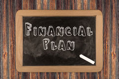 Financial Plan - chalkboard. With 3D outlined text - on wood Royalty Free Stock Photo