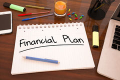 Financial Plan. Handwritten text in a notebook on a desk - 3d render illustration Royalty Free Stock Image