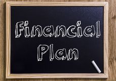 Financial Plan. New chalkboard with 3D outlined text - on wood Stock Photography