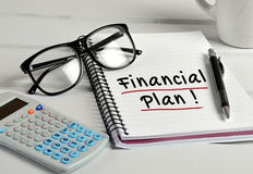 Financial Plan word on notebook Royalty Free Stock Photography