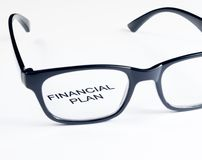 Financial plan words see through glasses lens, business concept Royalty Free Stock Photo
