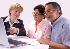 Financial planner. Mature couple talking to financial planner at home Royalty Free Stock Photo