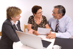 Financial planner. Mature couple talking to financial planner Royalty Free Stock Images