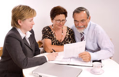 Financial planner. Mature couple talking to financial planner Stock Photos
