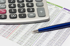 Financial planning. With calculator and blue ballpoint pen Stock Photography