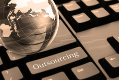 Financial planning and banking. Outsourcing button on computer keyboard Royalty Free Stock Photography