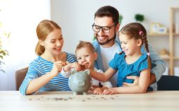 Financial planning   family mother father and children with piggy Bank at home stock image