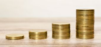 Financial planning, gold money coins, growing stock images