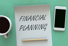 FINANCIAL PLANNING, message on paper, smart phone and coffee on table Stock Images