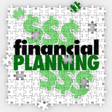 Financial Planning Puzzle Pieces Finish Budget Retirement Saving. Financial Planning words on puzzle pieces to illustrate finishing or completing your budget or Stock Images