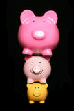 Financial pressure piggy banks Stock Photo