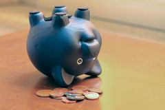 Financial problem concept with black piggy bank. Financial problem concept with black piggy bank upside down and coins Royalty Free Stock Photos