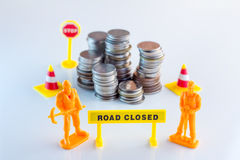 Financial problem concept coins stack with toy figure and sign Royalty Free Stock Photos