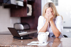 Financial problems. Crying young woman having financial problems Royalty Free Stock Photography