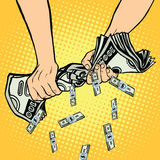 Financial profit, hands squeeze out of the money dollars. Pop art retro vector illustration Stock Images