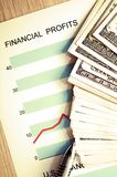 Financial profits. Dollars with document showing us financial profits Stock Image